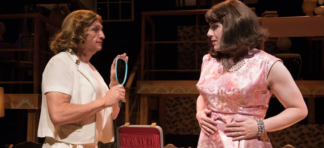 "Charlotte (Will McGarrahan) holds a mirror for Miranda (Greg Maraio) in the SpeakEasy Stage Company's production of ""Casa Valentina."" (Glenn Perry)"