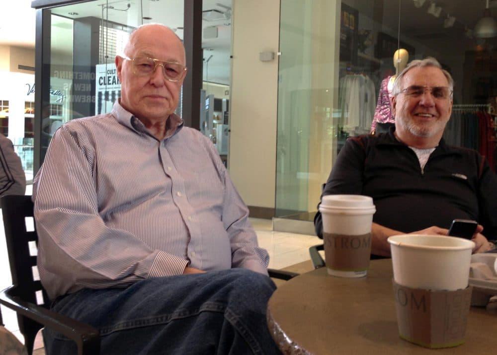 Jon Tucker (left), 76, has been a regular mall walker for 10 years. (Ruby de Luna/KUOW)