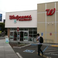 A pedestrian walks by a Walgreens store on July 9, 2015 in San Francisco, California. (Justin Sullivan/Getty Images)