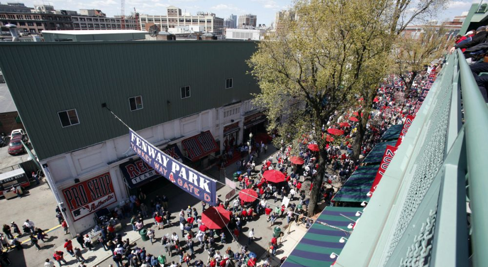 Tom Keane: The state inspector general is right. The BRA's 2013 land deal with the Red Sox could have been handled better. But the result still would have been the same. In this photo, fans walk on Yawkey Way outside Fenway Park before a baseball game between the Boston Red Sox and the Tampa Bay Rays in Boston, Friday, April 13, 2012. (Michael Dwyer/ AP)