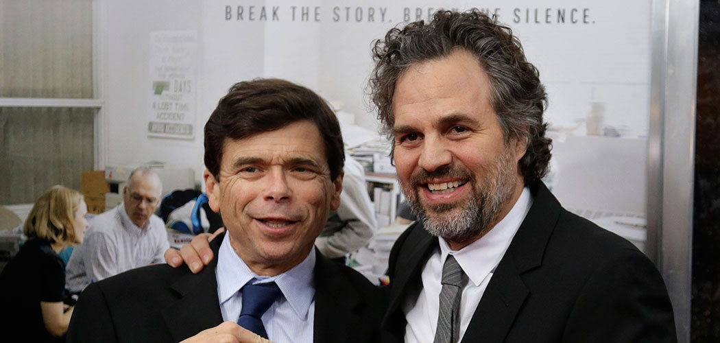 "Boston Globe reporter Michael Rezendes, left, stands for a photo with actor Mark Ruffalo, who plays Rezendes in the film ""Spotlight,"" as they attend the Boston-area premiere of the movie Wednesday at the Coolidge Corner Theatre in Brookline. The film tells the story of how The Boston Globe reported on the clergy sex abuse scandal. (Steven Senne/AP)"