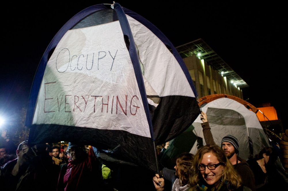 "University of California, Berkeley students set up tents after a general assembly voted to again occupy campus as part of an ""open university"" strike in solidarity with the Occupy Wall Street movement on November 15, 2011 in Berkeley, California.  (Max Whittaker/Getty Images)"