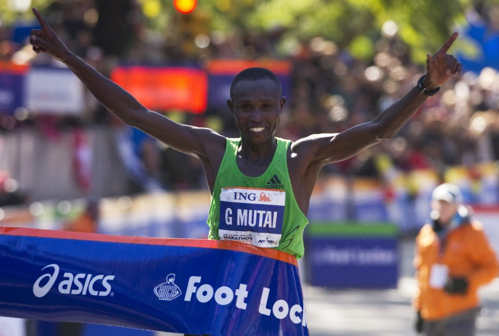 Geoffrey Mutai of Kenya crosses the finish line to win the ING New York City Marathon November 6, 2011 in New York. Mutai, the 2011 Boston Marathon winner, won the men's New York Marathon in an unofficial time of two hours, five minutes and five seconds to smash the course record on Sunday. (Don Emmert/AFP/Getty Images)