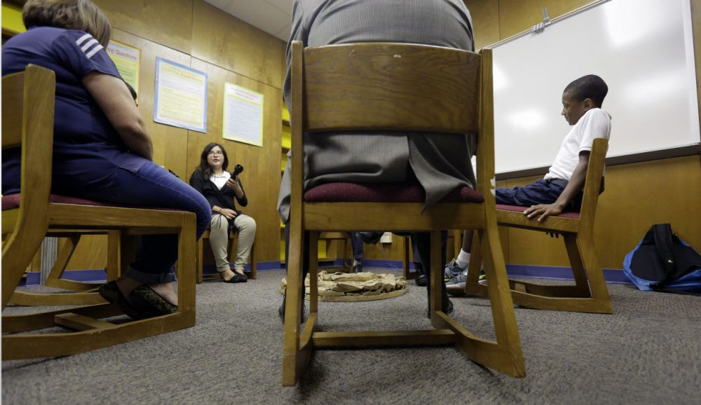 Two seventh graders discuss a recent conflict that they resolved through restorative justice, which included teachers and students gathering in circles for discussions, at Ed White Middle School, Friday, Oct. 16, 2015, in San Antonio. Philip Carney said that three years after starting a restorative discipline program as principal of Ed White Middle School in San Antonio, out-of-school suspensions have dropped by 72 percent. (Eric Gay/AP)
