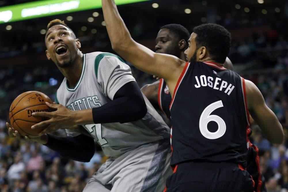 Toronto Raptors' Anthony Bennett, behind, and Cory Joseph (6) double-team Boston Celtics' Jared Sullinger (7) during Friday night's game in Boston. (Michael Dwyer/AP)