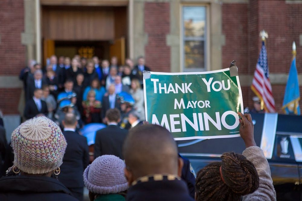 """A woman holds up a sign reading """"Thank You Mayor Menino"""" outside the church where his funeral was held on Nov. 3, 2014. (Jesse Costa/WBUR)"""