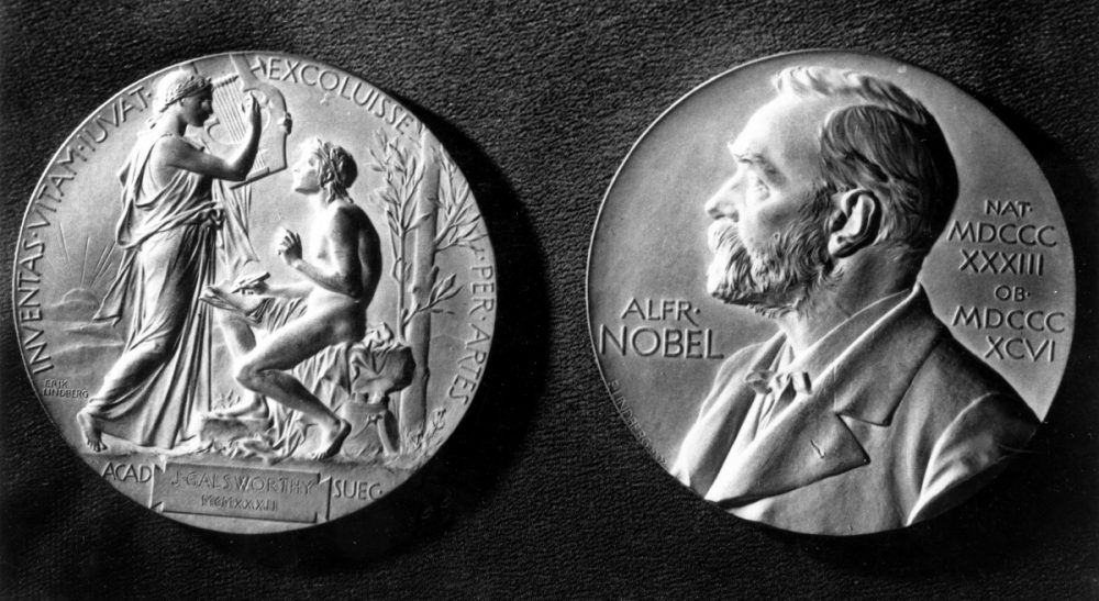 This photo shows both sides of the Nobel Prize Medal. The front side of the medal of the Swedish Academy features a profile of Alfred Nobel, the founder of the prize, with the dates of this birth and death in Latin. The medals are made of 23-karat gold. (AP)