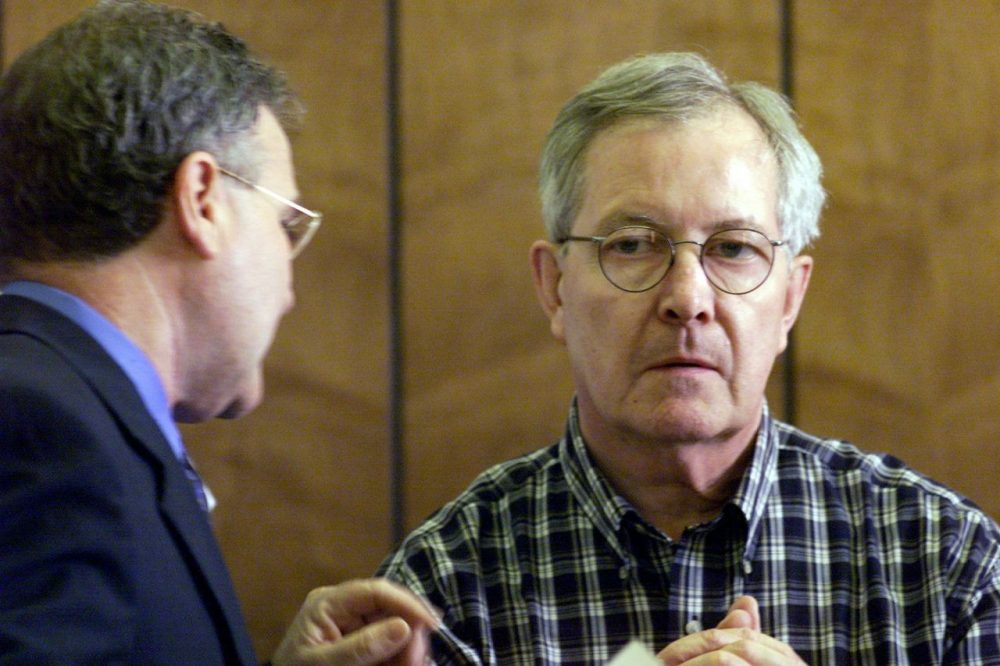 Retired priest Rev. Ronald Paquin, right, talks with his attorney in a 2002 file photo. (Tom Landers/AP)