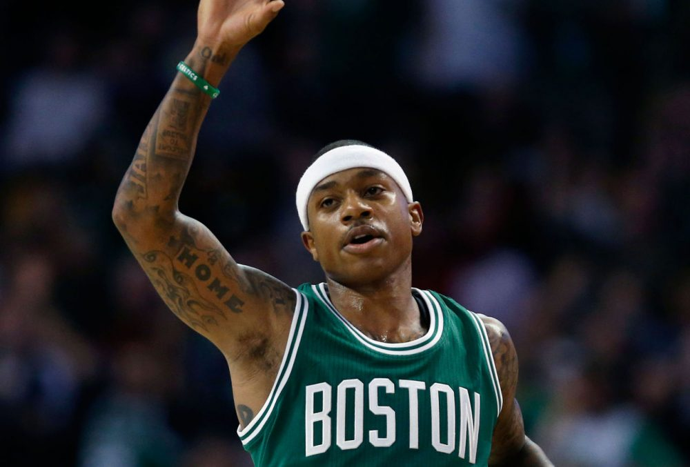 Boston Celtics' Isaiah Thomas celebrates after making a 3-pointer in the season opener Wednesday. (Michael Dwyer/AP)
