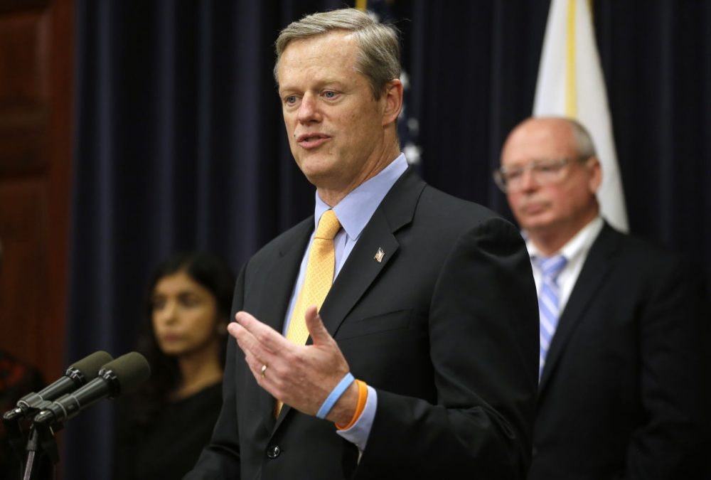 Gov. Charlie Baker faces reporters during a State House press conference Thursday, during which he announced legislation aimed at addressing the state's opioid abuse epidemic. (Steven Senne/AP)