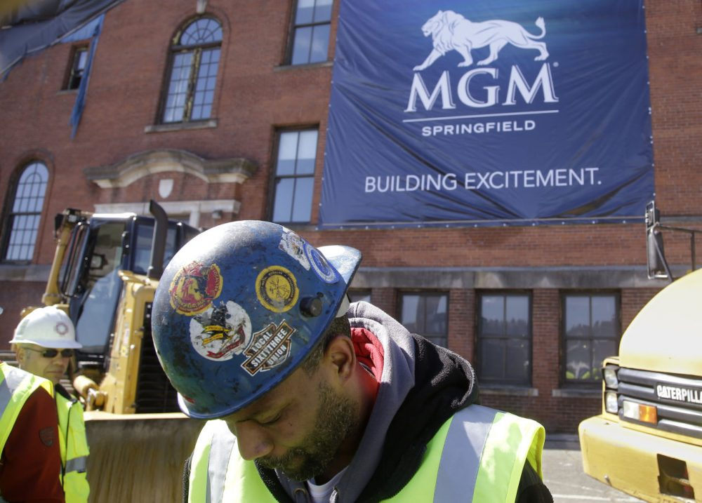 MGM says it plans to reduce the scope of its Springfield casino by 122,000-square feet. Pictured here, workers gather for the project's groundbreaking back in March. (Stephan Savoia/AP)