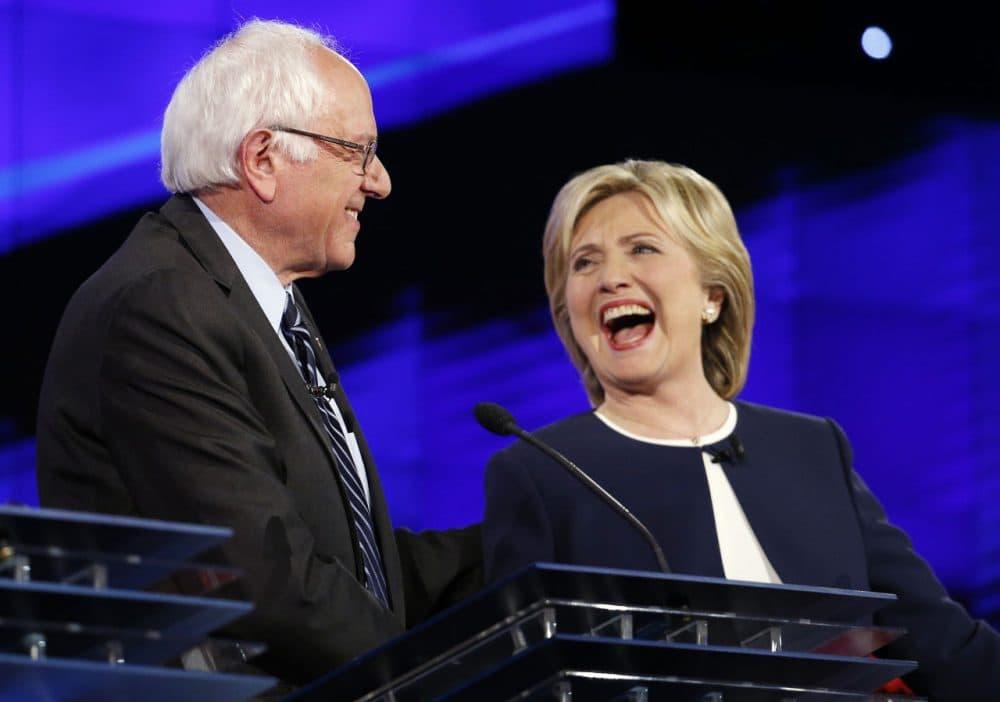 Sen. Bernie Sanders, of Vermont,, left, and Hillary Rodham Clinton laugh during the CNN Democratic presidential debate, Tuesday, Oct. 13, 2015, in Las Vegas. (AP Photo/John Locher)