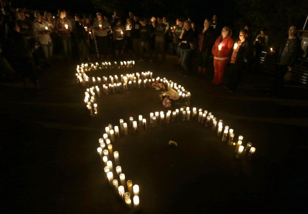 Candles spelling UCC -- for Umpqua Community College -- are displayed at a candlelight vigil for those killed during a fatal shooting at the school, Thursday in Roseburg, Oregon. (Rich Pedroncelli/AP)