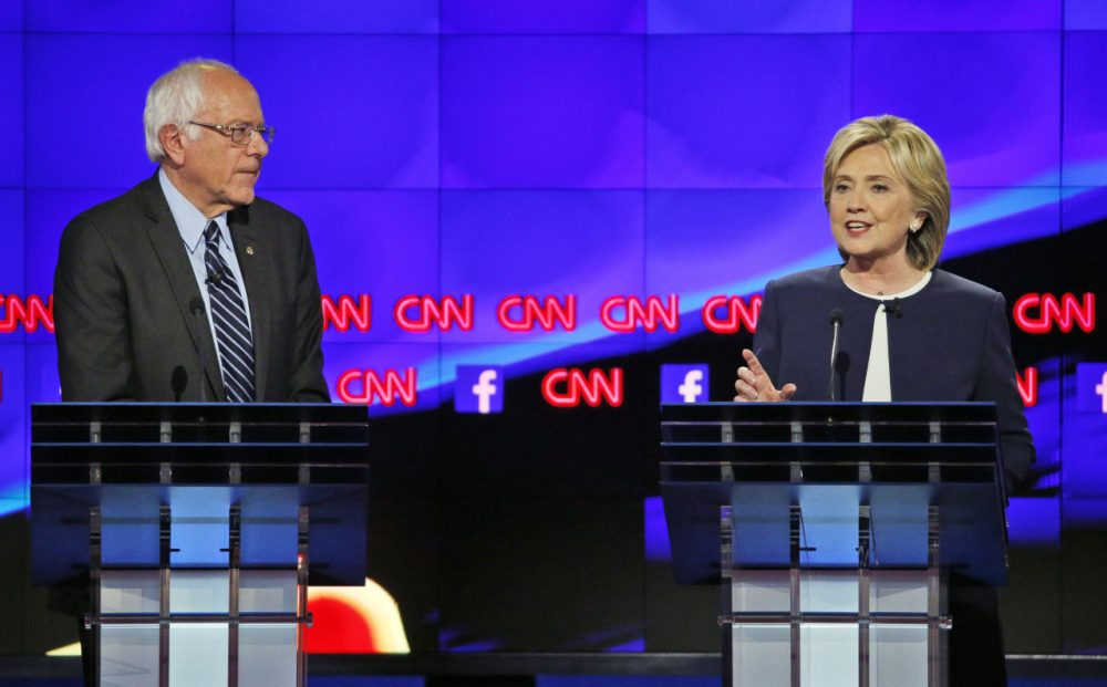 A new WBUR poll of likely Democratic primary voters finds Hillary Clinton edging ahead of Bernie Sanders in New Hampshire. Here are Clinton and Sanders during the Oct. 13 Democratic debate in Las Vegas. (John Locher/AP)