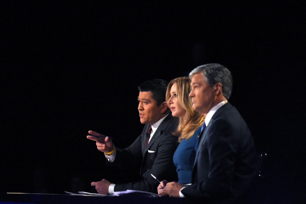Debate moderators Carl Quintanilla, left, Becky Quick, center, and John Harwood appear during the CNBC Republican presidential debate at the University of Colorado, Wednesday, Oct. 28, 2015, in Boulder, Colo.  (AP)