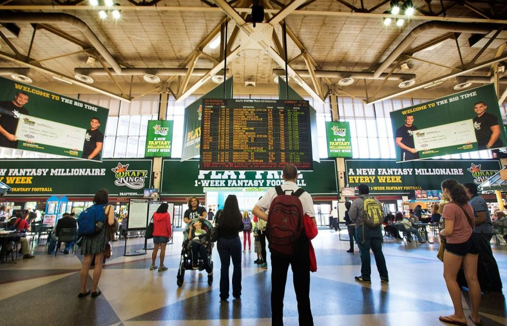 Advertisements for the online fantasy sports compant DraftKings, based in Boston, hang in South Station.  (WBUR)