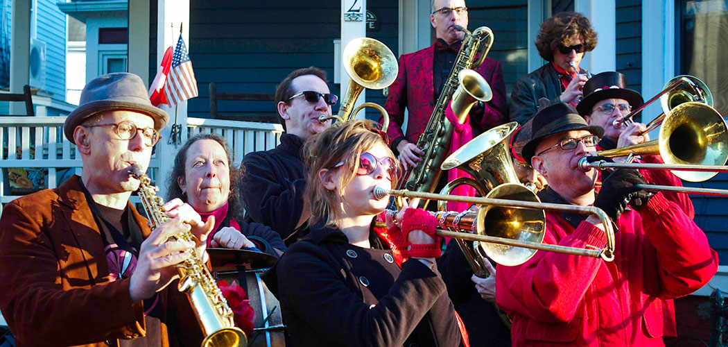Trudi Cohen (second from left) plays bass drum with the Second Line Social Aid and Pleasure Society Brass Band. (Jesse Edsell-Vetter)