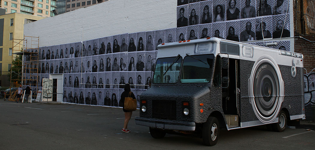 "Street artist JR's ""Inside Out Photobooth"" during a visit to Oakland. (Courtesy)"