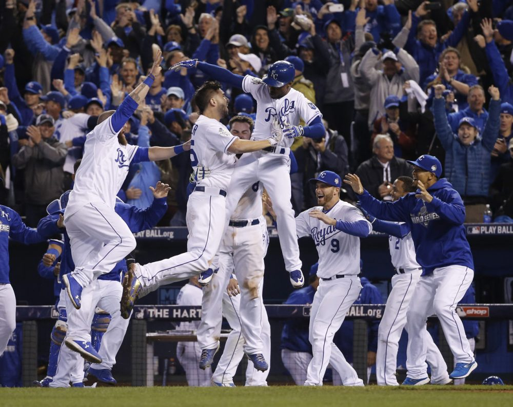 Kansas City Royals celebrate after winning the first game in the 2015 World Series in the 14th inning, concluding longest Game 1 in World Series history. (AP Photo/Matt Slocum)