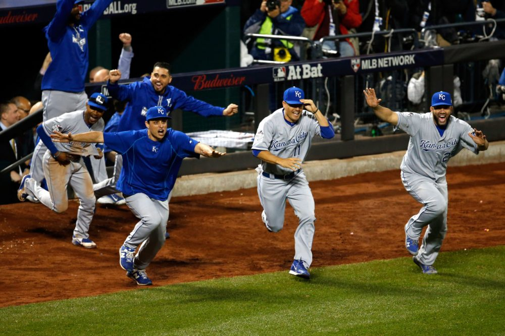 The Kansas City Royals dugout runs onto the field to celebrate defeating the New York Mets in Game Five of the 2015 World Series.  (Sean M. Haffey/Getty Images)