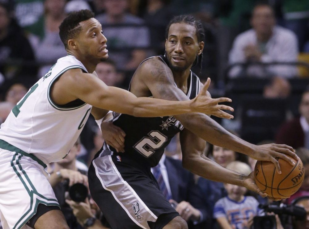 NBA star Kawhi Leonard, right, has reportedly signed with New Balance.  (Steven Senne/AP)