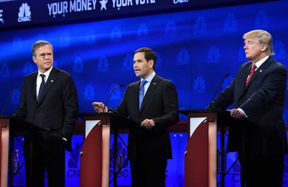 Republican Presidential hopeful Marco Rubio (C) had his breakthrough moment when he responded to fellow candidate, and one-time mentor Jeb Bush's reprimand with composure. (Robyn Beck/AFP/Getty Images)
