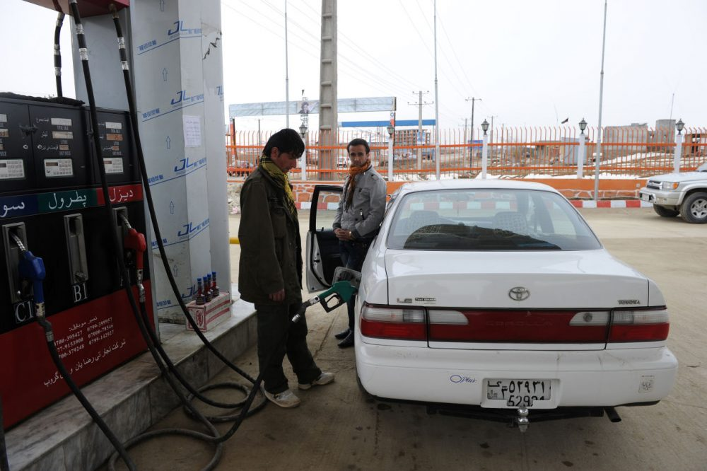 A petrol station employee fills up the tank of a car at a fuel station in the Shomali Plain, some 20 kilometers north of Kabul in Afghanistan on February 22, 2011. (Shah Marai/AFP/Getty Images)