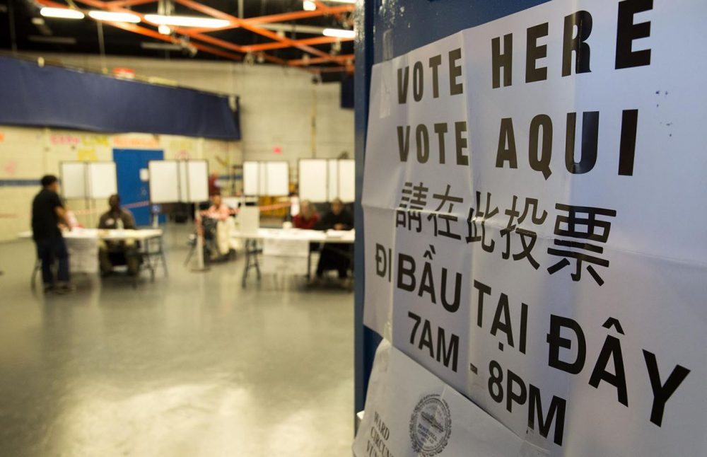 """A """"Vote Here"""" sign is seen at the Jackson/Mann School in Boston's Allston on Tuesday. (Robin Lubbock/WBUR)"""
