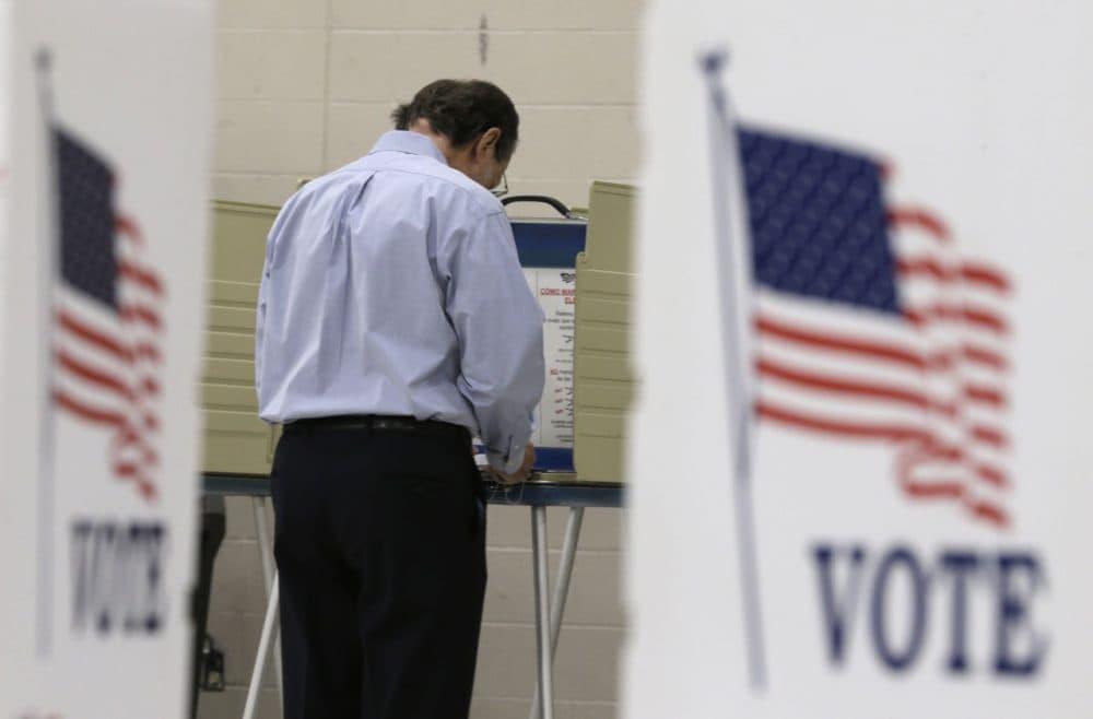 A voter casts his ballot at Orange High School in Moreland Hills, Ohio on Tuesday, Nov. 3, 2015. (Tony Dejak/AP)