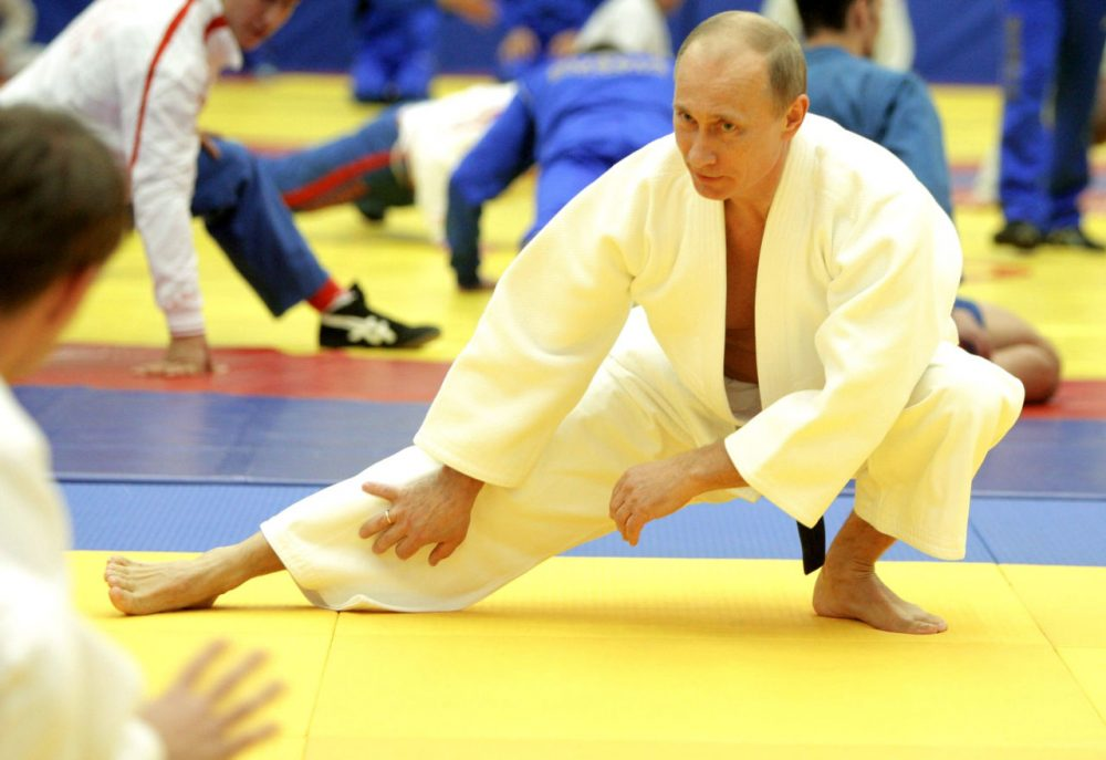 "Russia's Prime Minister Vladimir Putin takes part in a judo training session at the ""Moscow"" sports complex in St. Petersburg, on December 22, 2010. (Alexey Druzhinin/AFP/Getty Images)"