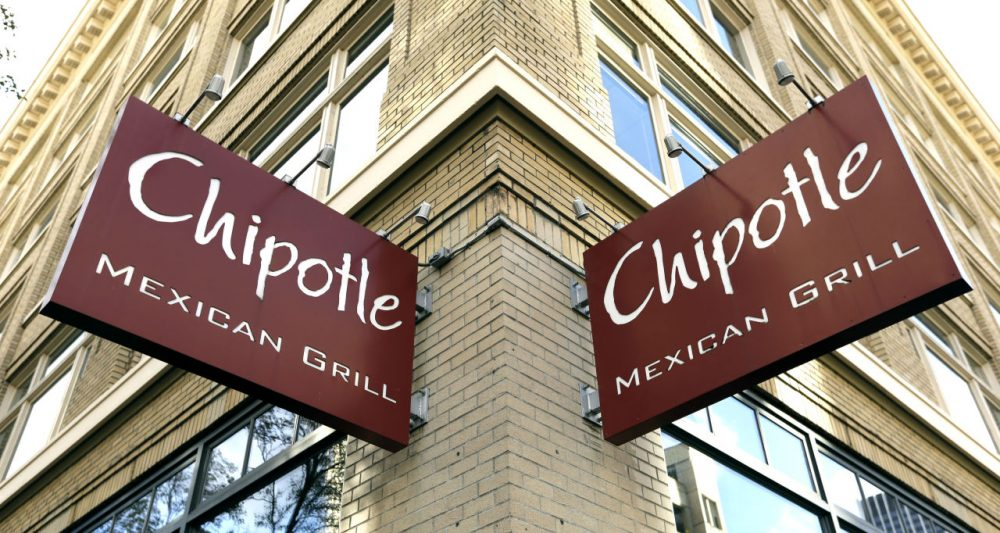 Signage hangs from a closed Chipotle restaurant in Portland, Ore., Monday, Nov. 2, 2015. Chipotle voluntarily closed down 43 of its locations in Washington and the Portland area as a precaution after an E. coli outbreak linked to six of its restaurants in the two states has sickened 37 people. (Don Ryan/AP Photo)