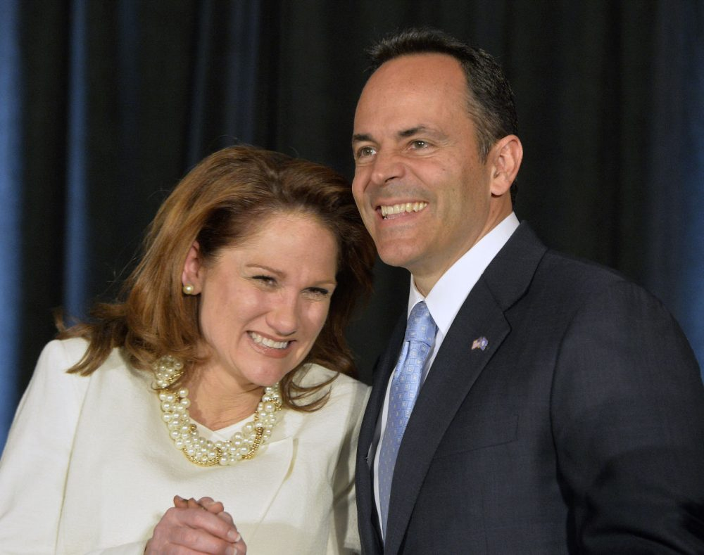 Kentucky Republican Governor-elect Matt Bevin, right, and his wife Glenna react to the cheers of supporters during his introduction at the Republican Party victory celebration, Tuesday, Nov. 3, 2015, in Louisville, Ky. (Timothy D. Easley/AP Photo)