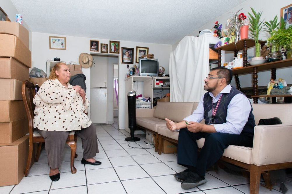 Walfred Lopez, a community health worker at the Los Angeles County-USC Medical Center, visits patient Maria Rivera, 48, at her home in La Puente, Calif., on Oct. 9, 2015. Rivera says she depends on Lopez to understand what is happening with her health. (Heidi de Marco/KHN)