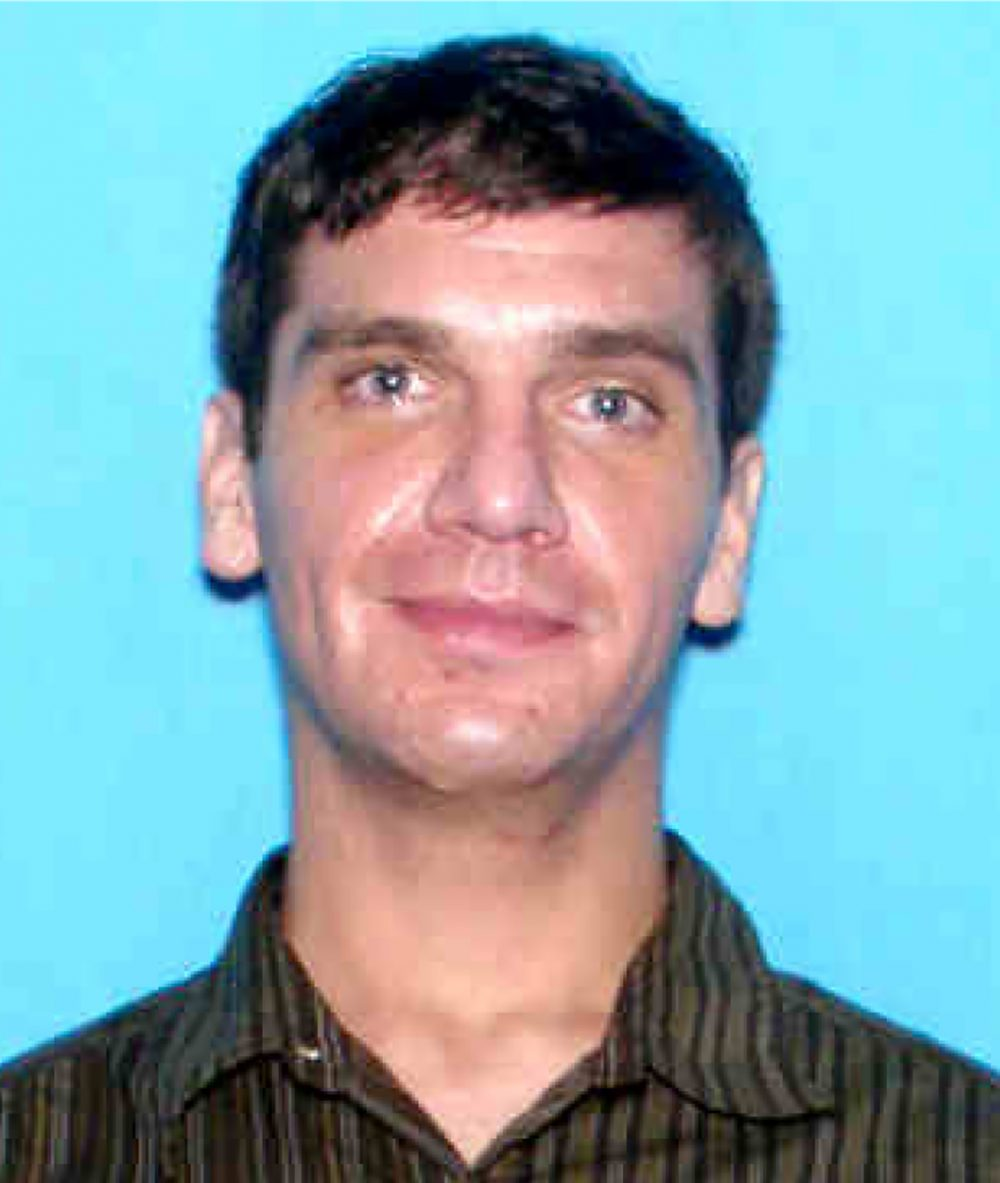 The Colorado Springs Police Department released this photo Monday, Nov. 2, 2015, of Noah Jacob Harpham, the suspect in the shootings Saturday, Oct. 31, 2015, in Colorado Springs, Colo. Harpham, who fatally shot three people during a rampage through the streets of Colorado Springs was a recovering alcoholic who posted an online video two days earlier expressing displeasure with his father for allegedly falling under the sway of a particular preacher — but gave no indication of the violence to come. (Colorado Springs Police Department via AP)