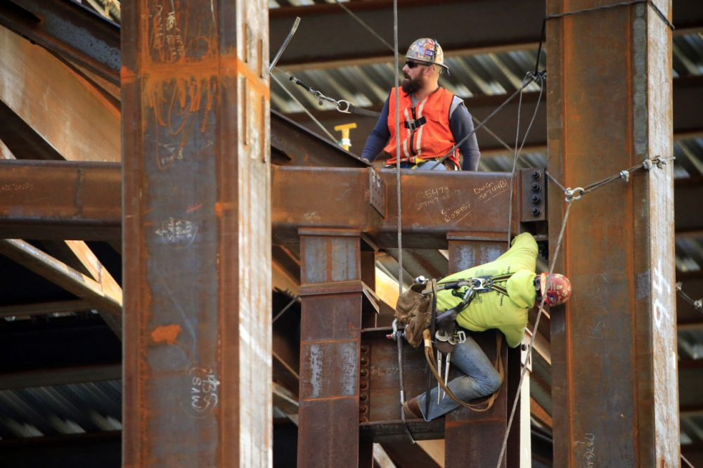 Iron workers help to build the new Comcast Innovation and Technology Center under construction, Friday, Oct. 23, 2015, in Philadelphia. (Matt Rourke/AP)