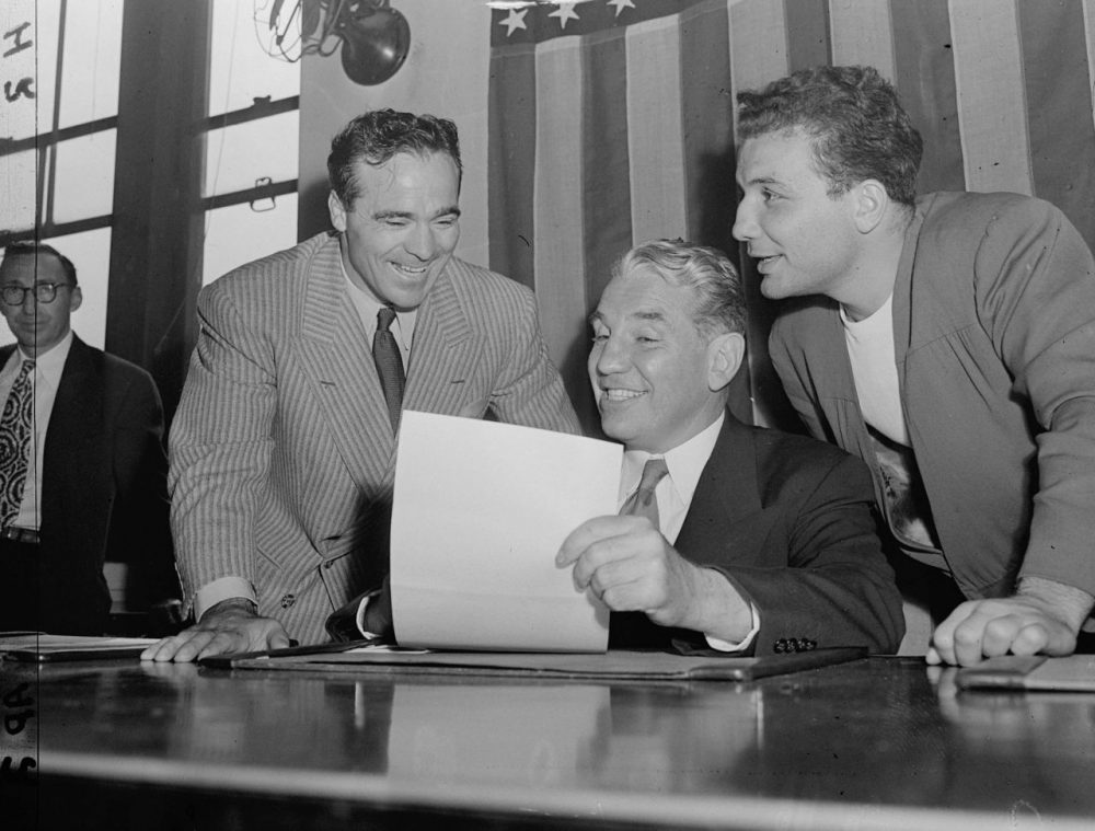 Eddie Eagan, center, was one of four men on the 1932 American Olympic bobsledding team. Not only did he become a two-time gold medalist, Eagan was a talented boxer and lawyer who later became chairman of the New York State Athletic Commission (AP)