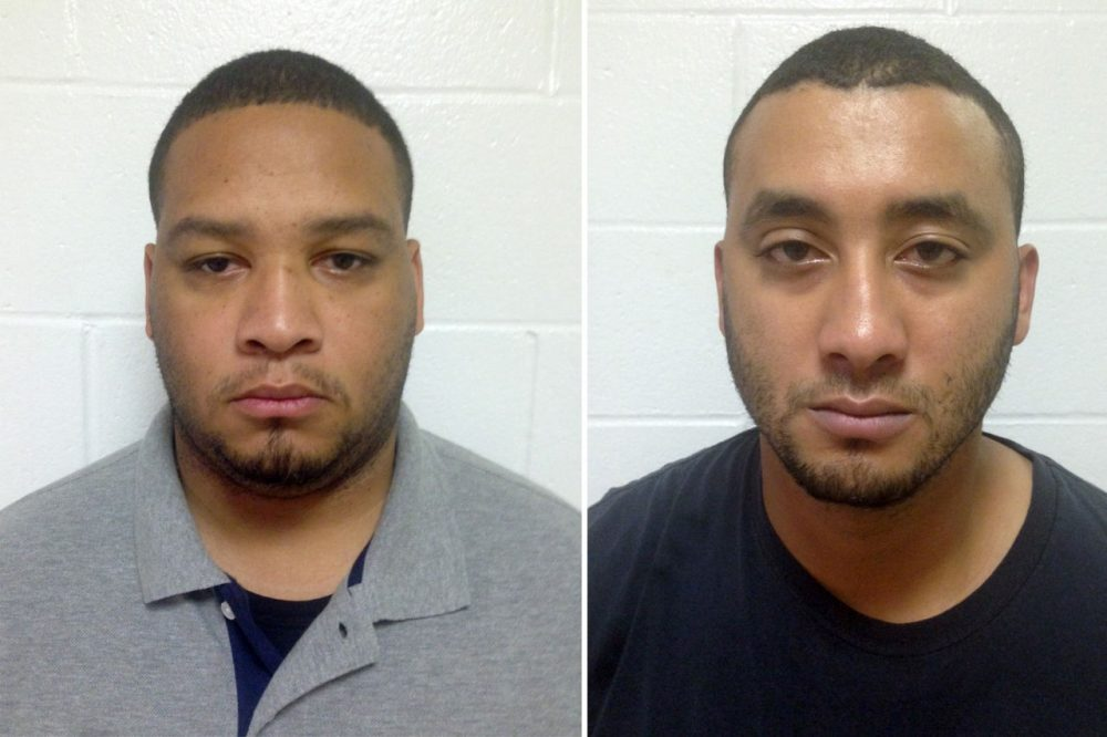 These booking photos provided by the Louisiana State Police show Marksville City Marshals Derrick Stafford (L) and Norris Greenhouse Jr. (R), who were arrested on charges of second-degree murder and attempted second-degree murder in the fatal shooting of Jeremy Mardis, a 6-year-old autistic boy, on Tuesday in Marksville, La. The shooting also wounded Mardis' father, Chris Few. (Louisiana State Police via AP)