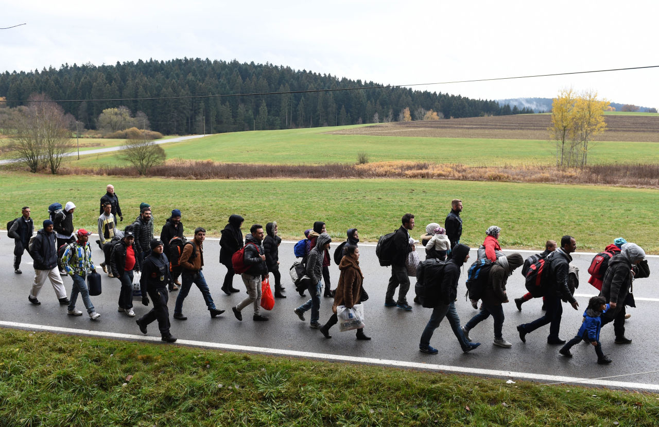 Migrants walk on the road after crossing the Austrian-German border near the Bavarian village of Wegscheid, southern Germany, on November 9, 2015. (Christof Stache/AFP/Getty Images)