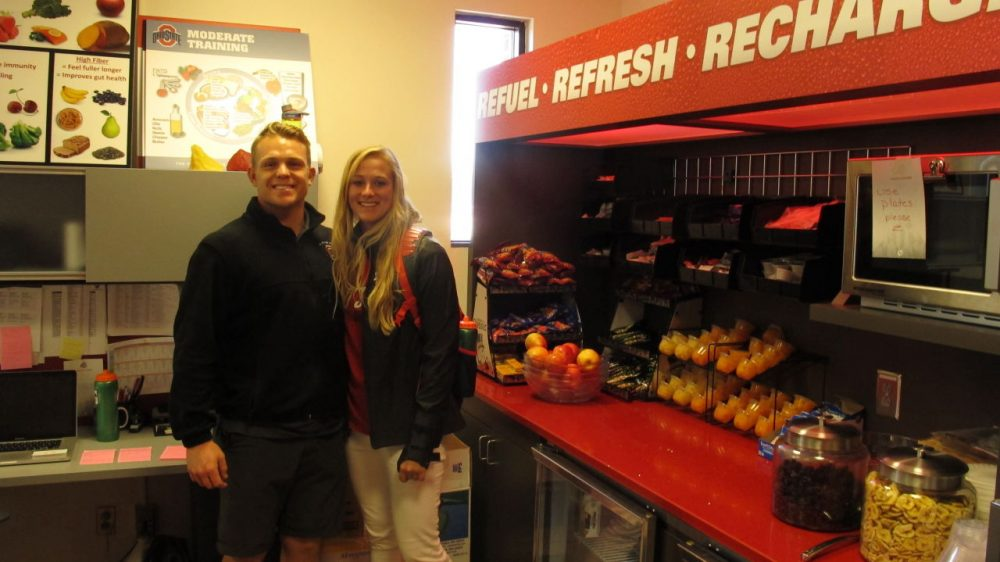 Ohio State softball player Maddy McIntyre (right) with sports nutrition intern Sebastian Zorn at one of the new fuel zones on campus. (Martin Kessler/Only A Game)