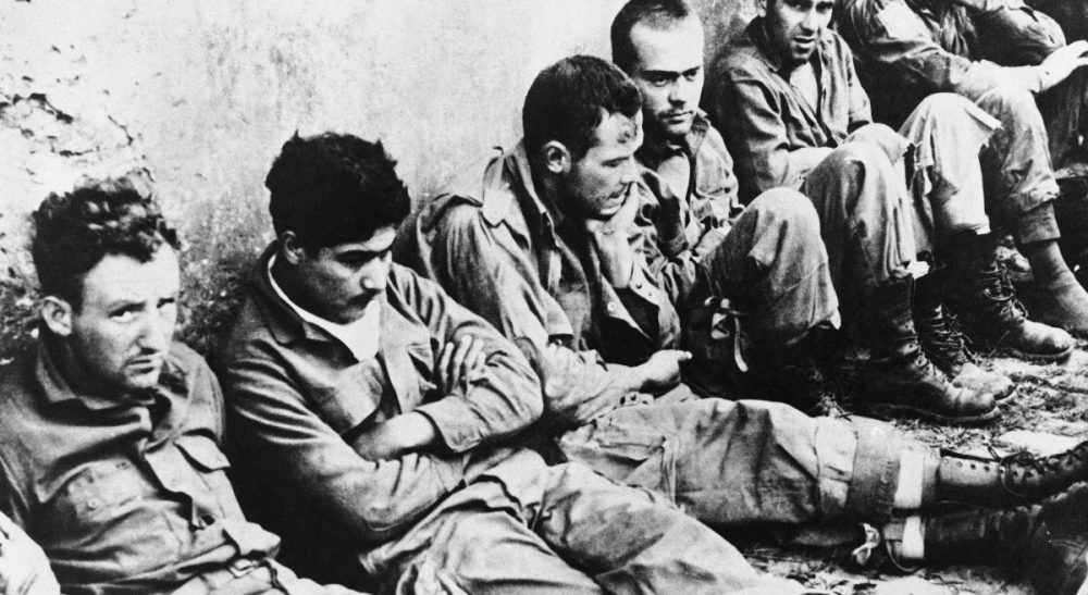 Wendy Kaminer: My  late uncle never talked to me at length about his wartime experience, but in his late 60s, he wrote a play about it. I regret never asking what was fact and fiction. In this photo, American prisoners waiting for transportation towards Germany after their capture in Normandy on August 2, 1944. (AP)