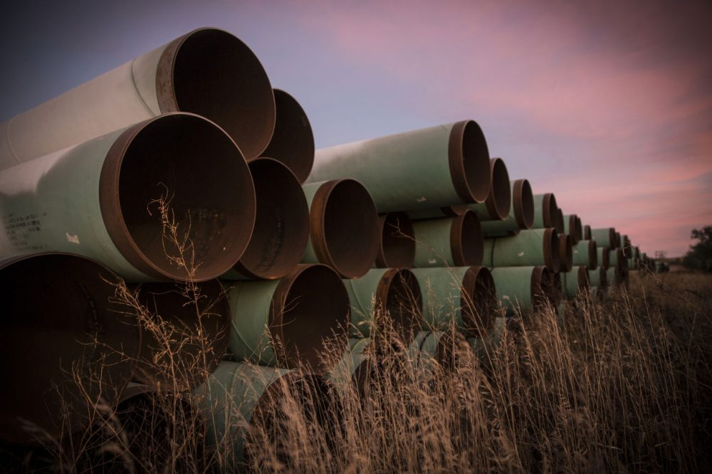 Miles of unused pipe, prepared for the proposed Keystone XL pipeline, sit in a lot on October 14, 2014 outside Gascoyne, North Dakota.  (Andrew Burton/Getty Images)