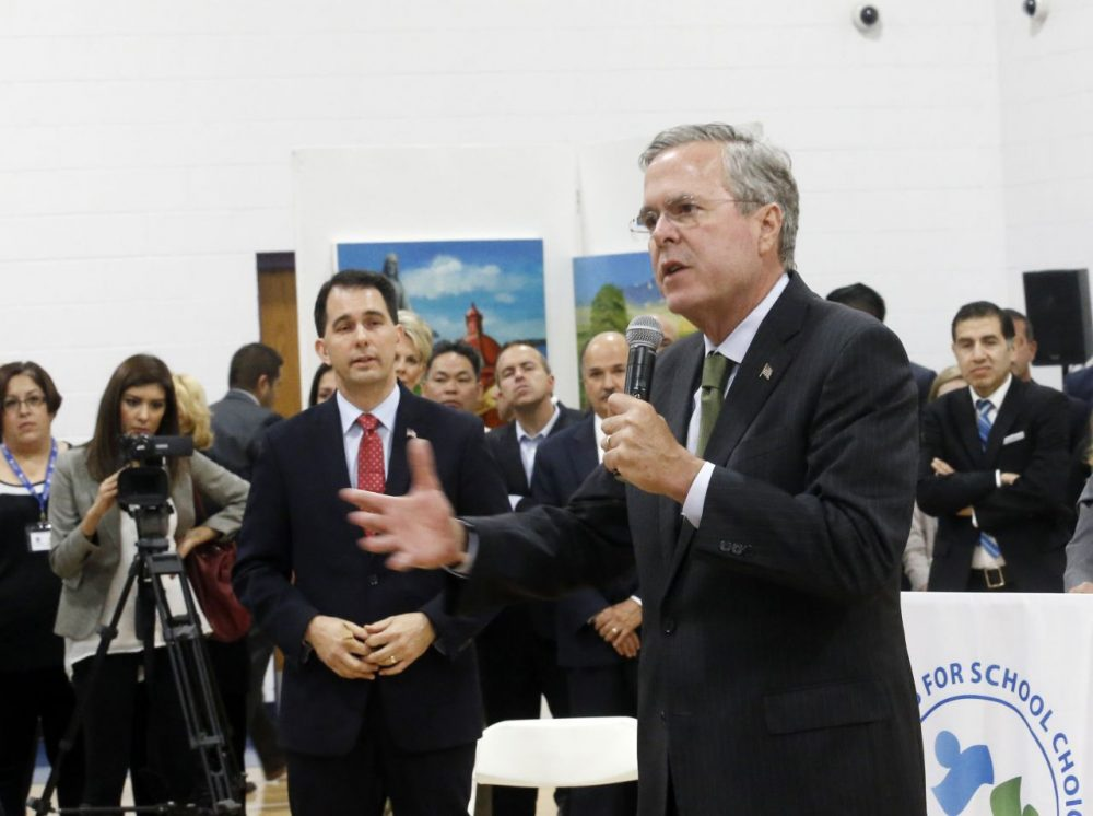 Republican presidential candidate, former Florida Gov. Jeb Bush and Wisconsin Gov. Scott Walker Monday at a campaign event in Waukesha, Wis. (Morry Gash/AP)
