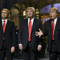 "Taran Killam, left, Republican presidential candidate and guest host Donald Trump, center, and Darrell Hammond perform during the monologue on ""Saturday Night Live"", Saturday, Nov. 7, 2015. Trump's 90 minutes in the ""SNL"" spotlight followed weeks of growing anticipation, increasingly sharp criticism and mounting calls for him to be dropped from the show. (Dana Edelson/ AP)"
