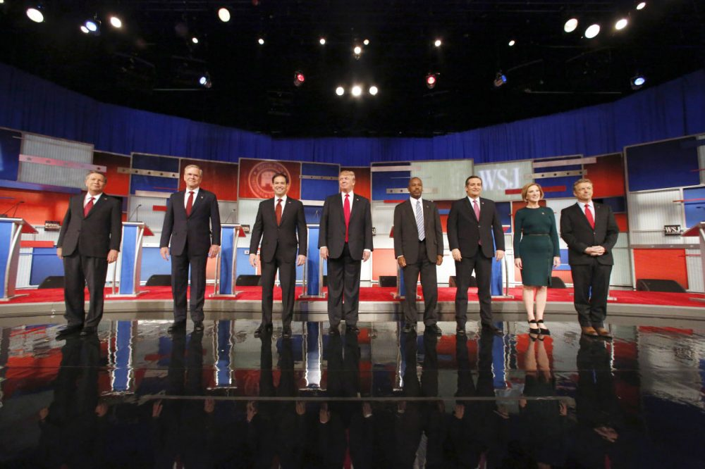 Republican presidential candidates (left to right) John Kasich, Jeb Bush, Marco Rubio, Donald Trump, Ben Carson, Ted Cruz, Carly Fiorina and Rand Paul take the stage before the Republican presidential debate at the Milwaukee Theatre, Tuesday, Nov. 10, 2015, in Milwaukee. (Jeffrey Phelps/AP Photo)