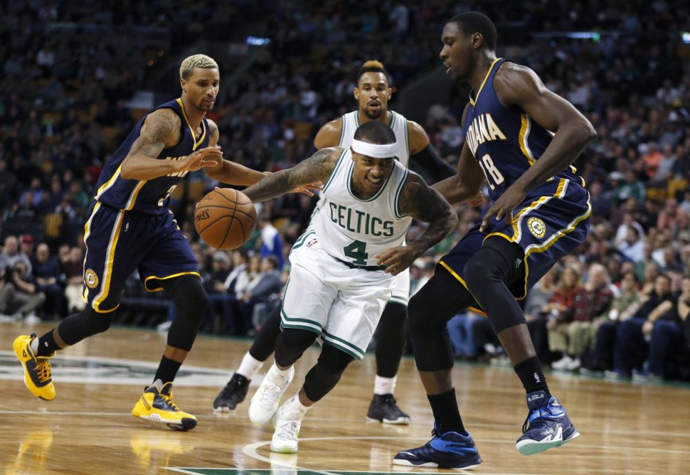 Boston Celtics' Isaiah Thomas (4) drives past Indiana Pacers' Ian Mahinmi (28) during the  game in Boston, yesterday. The Pacers won 102-91. (Michael Dwyer/AP)