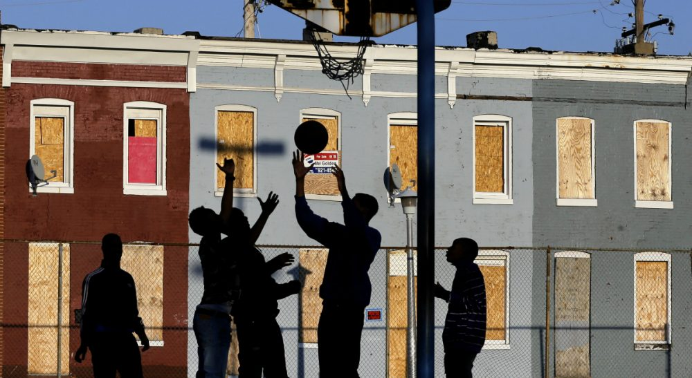 Countless Americans are living on virtually no income.The shocking fact of these families and the complexstrategies they use to survive is a national disgrace, says Renée Loth. In this photo, children play basketball at a park near blighted row houses in Baltimore, Monday, April 1, 2013. (Patrick Semansky/ AP)