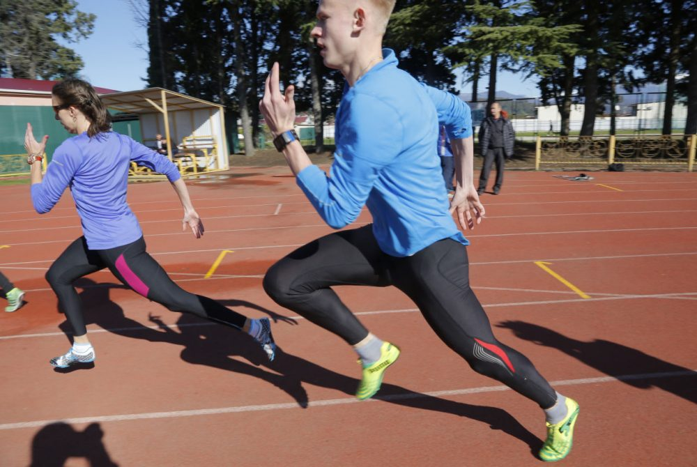 Athletes and their coaches attend a training session at the 'Yunost' sports ground at the Black Sea resort of Sochi, Russia, Thursday, Nov. 12, 2015. Facing allegations that Russia engages in extensive, state-sponsored doping, President Vladimir Putin on Wednesday called on sports officials to carry out an internal investigation - but said that clean athletes shouldn't be punished for the actions of those who take banned drugs. (Dmitry Lovetsky/AP)