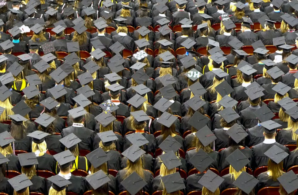 Graduates of the class of 2014 carry an average student loan debt of $28,950, according to the Institute for College Access and Success. (whatcouldgowrong/Flickr)