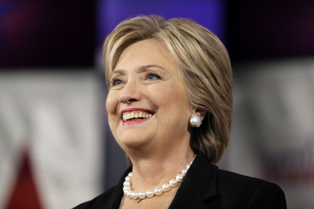 Hillary Rodham Clinton smiles as she takes the stage during a Democratic presidential primary debate on Saturday in Des Moines, Iowa. (Charlie Neibergall/AP)