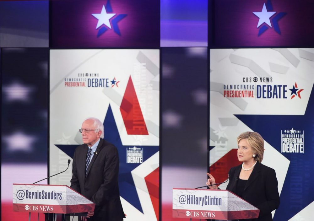 Democratic Presidential hopeful Hillary Clinton (right) speaks next to Bernie Sanders during the second Democratic presidential primary debate in the Sheslow Auditorium of Drake University on November 14, 2015 in Des Moines, Iowa. (Mandel Ngan/AFP/Getty Images)
